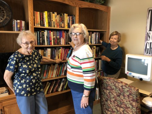 Jean, Joan, and Dorothy organizing the Library.