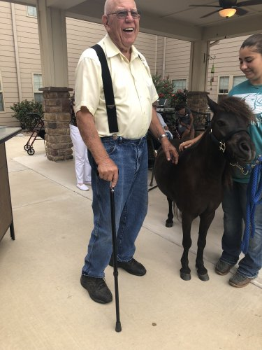 John's smile says it all. He loved getting to meet Baxter the mini horse.