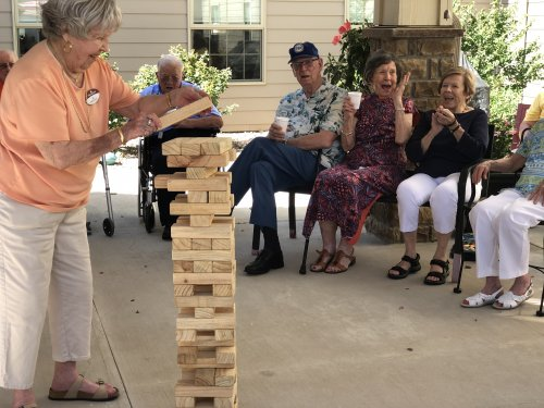 Everyone enjoyed watching Jo Niles play Jenga at our annual summer party.