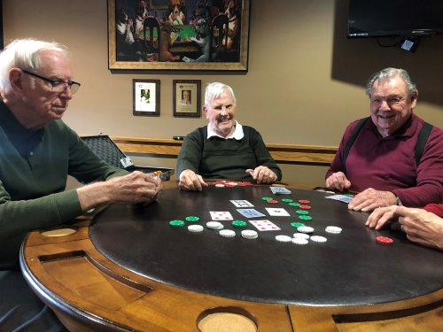 The guys having a fun game of poker.