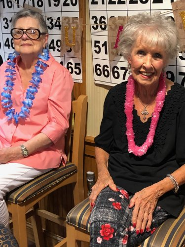 Margaret and Alice enjoy a great time at the Luau Social.