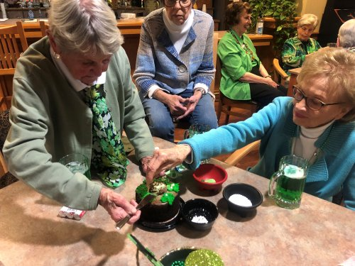 Decorating cakes during the St. Patty's Social