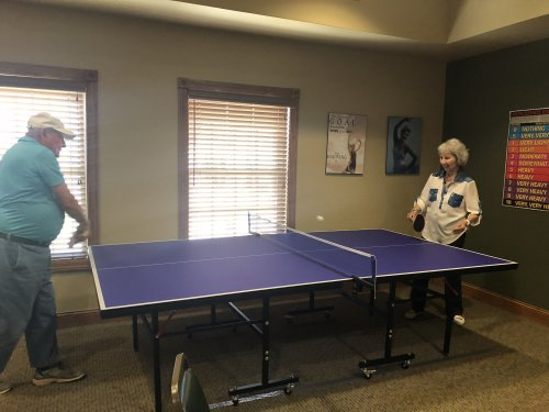 Bill and Iris playing a game of ping pong. Iris informed everyone that she won, Bill let us know that he let her win.