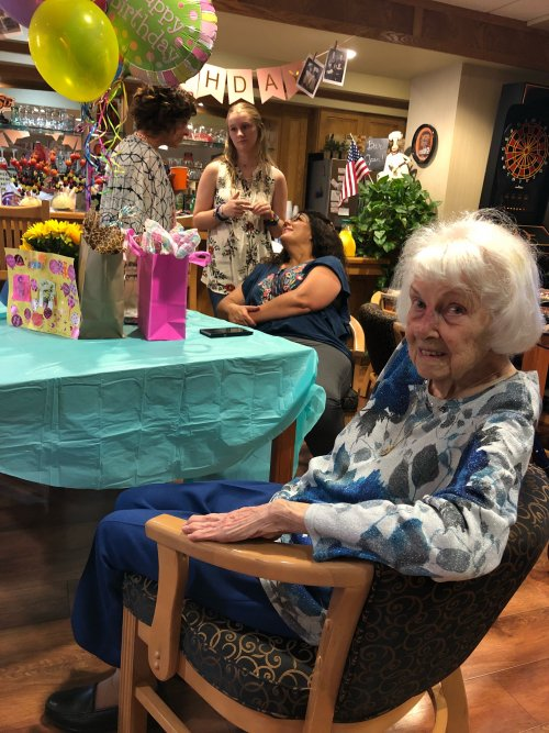 Mrs. Irene celebrating her 100th birthday with her family.