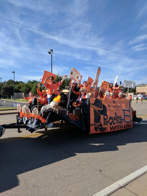 Some staff and residents on the Homecoming Parade float. Primrose Rocks for OSU!