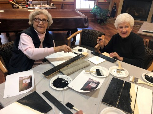 Joan and Jo working on a Christmas craft.