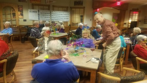 Residents enjoying the Mardi Gras Party.