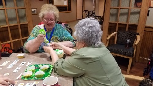Virginia and Marilyn decorating their cake for the St. Paddy's Day cake decorating contest.