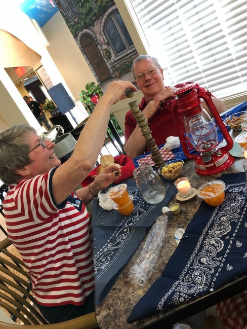Janet building a tower of butter while her husband, David, knows it's about to fall. All the residents had fun during Camp Primrose.