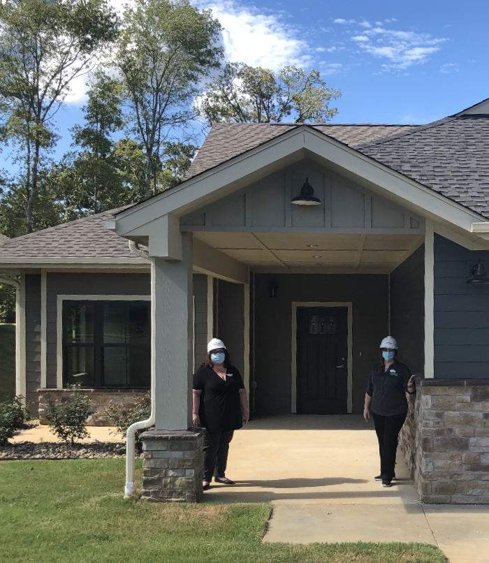 Sarah Klepfer (Sales Director) and Chelsea Owens (Executive Director) brave the heat with hardhats and masks to get a first glimpse at the beautiful Primrose of Tyler Villas.