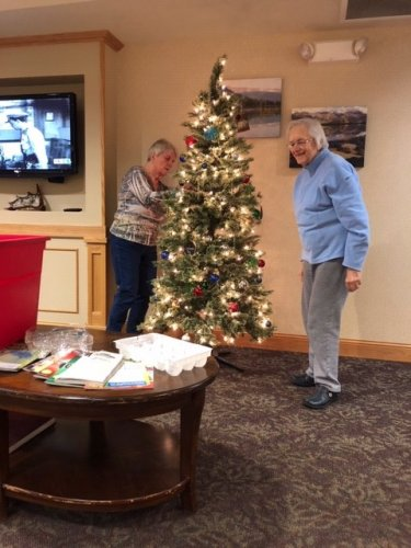 Residents Grace and Regina helping make the lounge look a lot like Christmas!
