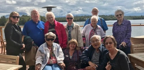 The out to lunch group enjoying the deck and Wasilla Lake view at Everett's.