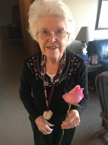 Becky with a rose dropped off from our local Carrs store.