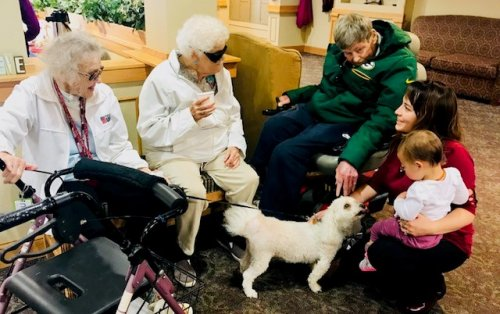 Just your typical day at Primrose! Residents Mary, Phillis, and Larry with Admin Assistant Laine, her Daughter, and Mary's dog.