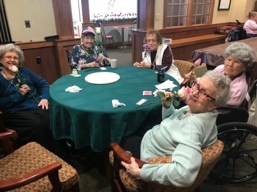 The ladies playing cards and loving the roses Carrs store dropped off for the residents. We are ready for spring!