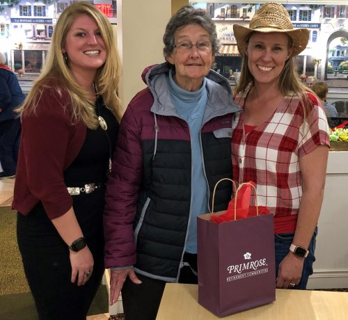 Patricia in the middle after Dana & Tauna present her with 1st place prize. Patricia's chili was voted best by residents & staff!