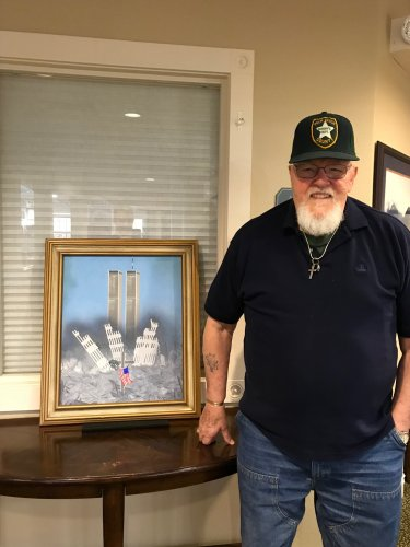 Resident Bob showing us the picture his late wife painted in remembrance of 9-11.