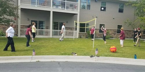 Primrose staff on lunch doing a game of volleyball for the residents to enjoy.