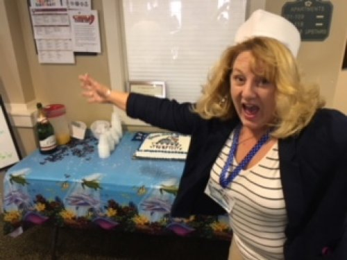 Sales Director Sherrille at the Sip-N-Sea open house.