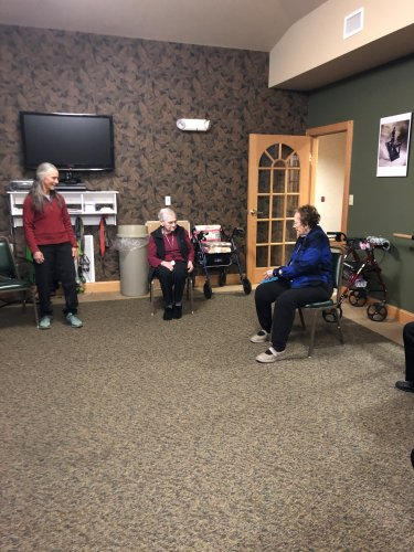 The residents love balance class with Dottie.