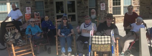 Primrose residents participating in our Primrose parade are helping decorate our 4th of July float.