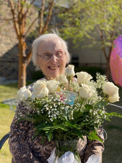Eleanor showing off her beautiful roses for her 85th birthday!