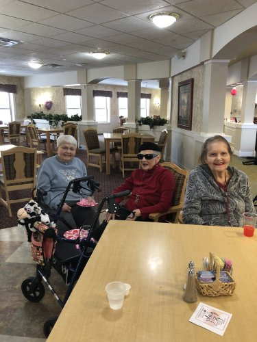 Jean, Patricia,& Esther dressed for the day, enjoying the music & each others company at the Valentines Day party.