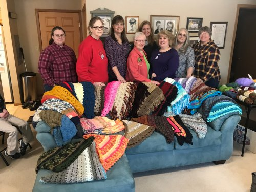 The Circle Of Love Prayer Shawl Group started by resident Peggy