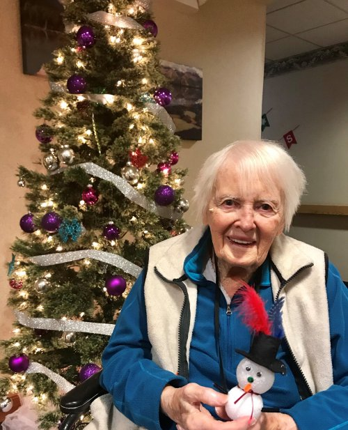Resident Peggy and her snowman from craft class.