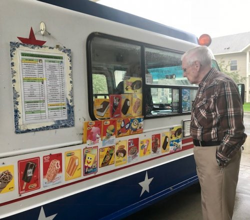 Resident Richard trying to make a choice from the ice-cream truck.