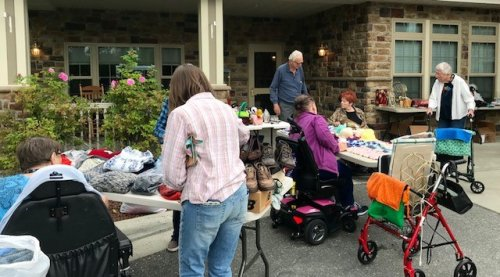Residents selling items at our rummage sale.