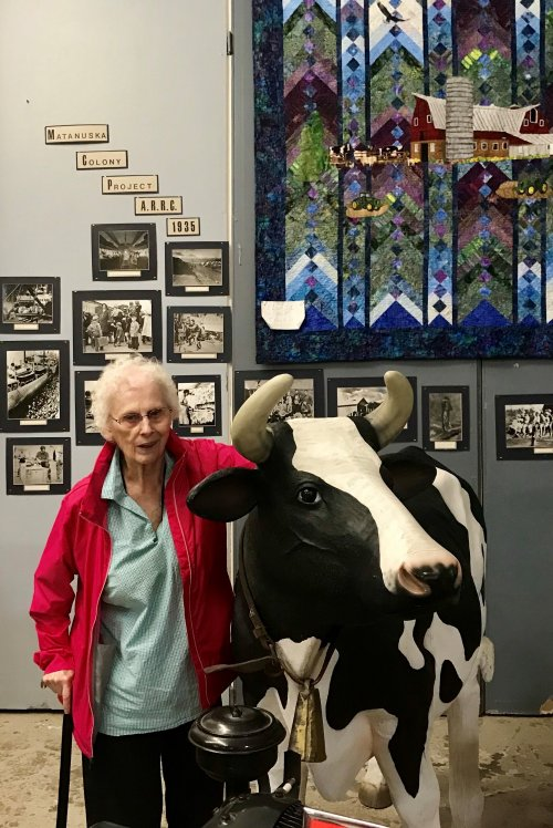 Resident Eleanor with her new cow friends at the Transportation Museum.
