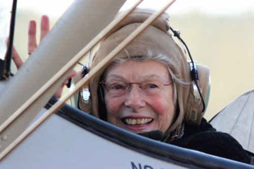 Gay ready for take off in a Stearman biplane with Ageless Aviation Dream Flight in honor of her late husband who was a Veteran.