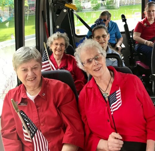 Everyone is ready in red white and blue to represent Primrose in the Wasilla 4th if July Parade.