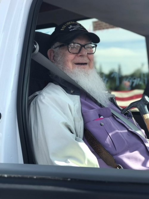 WWII POW Walt riding the bus in the Wasilla 4th of July Parade themed 'honoring American Heroes'