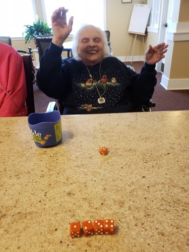 Carol wins with a straight with Yahtzee