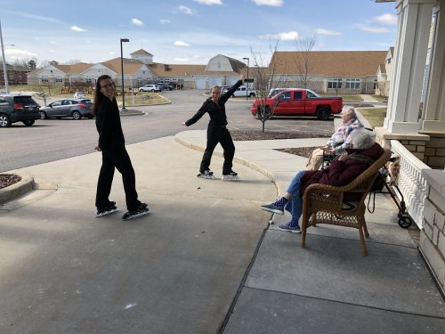 The nursing staff entertain outside with roller blading on this warm day. The residents had a good laugh.