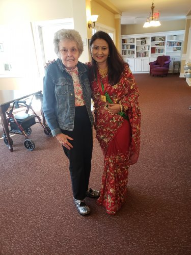 Sangita (Dietary Chef) shows her dress to Vi which is from Nepal.
