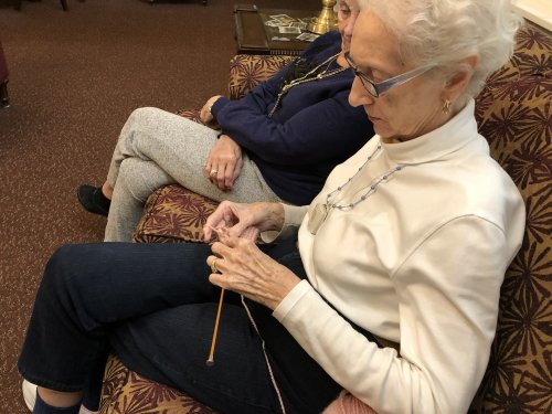 Diane's has set a goal to Knit a shoulder shawl for herself, then decided to knit one for other residents too.