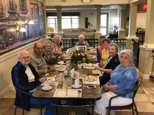 Resident's Socialize at Lunch Celebrating Wally and Marge's 78th Anniversary with Wine and Champagne. During Lunch.