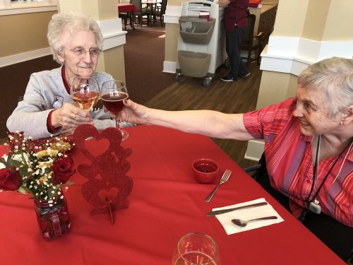 Virginia and Lori toast each other as they prepare for the Valentine's Day Dinner. Shrimp and steak on the menu. YUM.