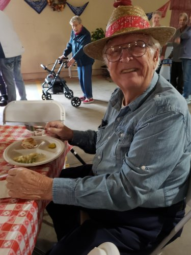 Ed enjoys his meal at the Barn Dance while he listens to live music.