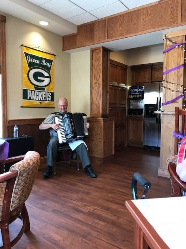 During happy hour for the 'Longest Day' Rich Pinski played a variety of music on his accordion.
