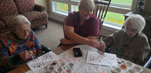 Brenda is helping with painting fall leaves. Everyone is starting to miss summer with this weather.
