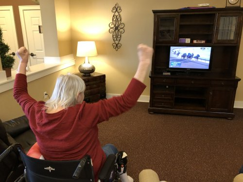 Lori cheers on her favorite horse for horse races.