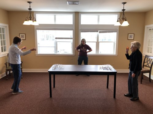 Water Pong - Rules are: stand 6 feet part-ball is sanitized between throws-and get it in the cup to win.