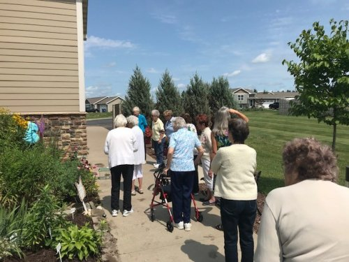 Resident's Gather for the Butterfly Release. This year we had 5 Monarch Butterflies We Watched form Caterpillar to Butterfly!