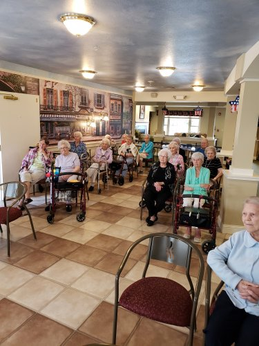 This years theme for 'The Longest Day' was fine dining and music. In this picture residents listened to Mary Ament playing her harp in the café before lunchtime.