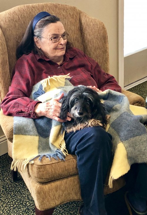 Resident Gail and her fur baby Schnitzel enjoying the music