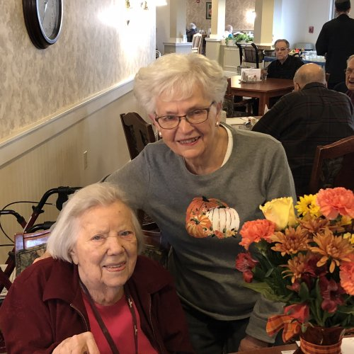 Residents sharing a birthday celebration during lunch.